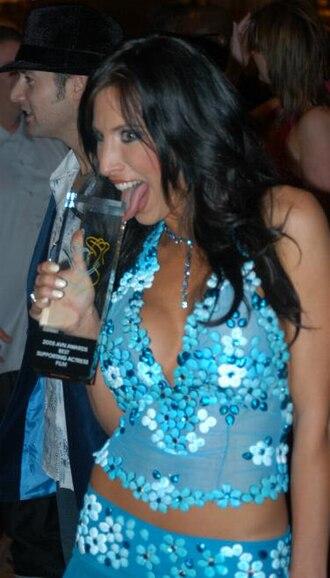 Lezley Zen - Lezley Zen holding her AVN Award for Best Supporting Actress, Film on January 8, 2005