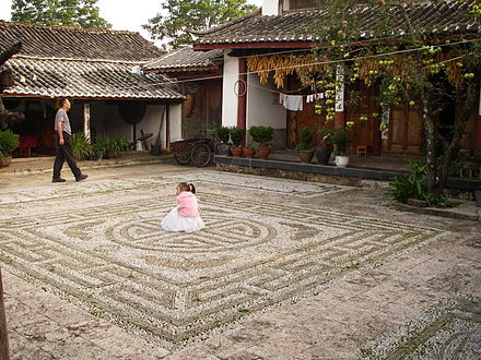 A 'Direct Method' mosaic courtyard made from irregular pebbles and stone strips, Li Jiang, Yunnan, PRC (China) Li Jiang Guesthouse.jpg