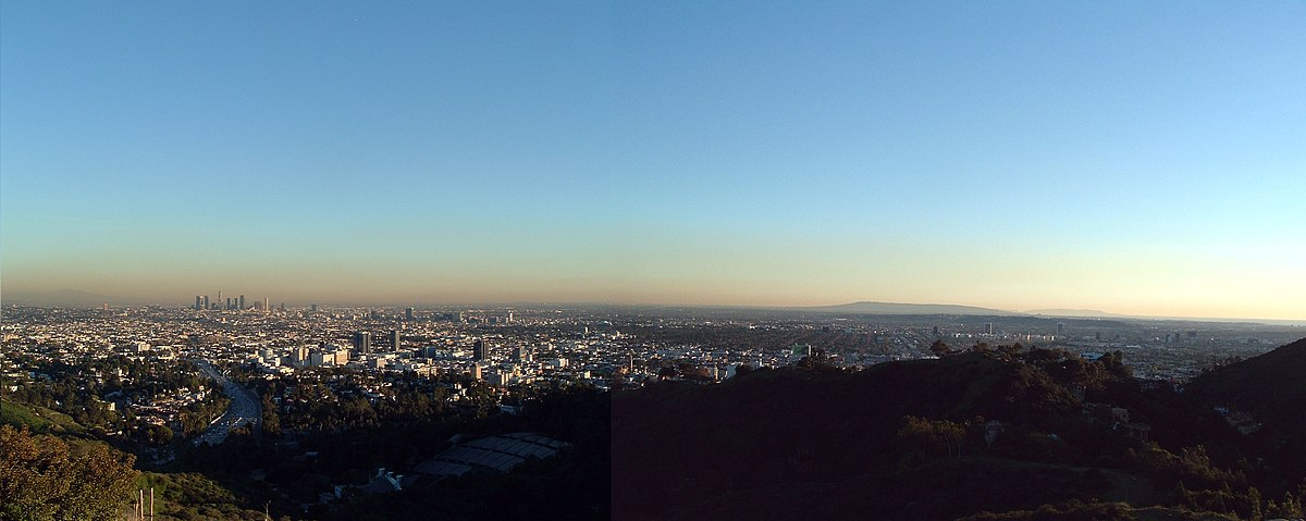 The Los Angeles Basin, viewed south from Mulholland Drive. From left to right can be seen the Santa Ana Mountains / Saddleback (horizon), downtown L.A., the Hollywood Bowl (foreground), Mid-Wilshire, Long Beach – Palos Verdes (background), Catalina Island (horizon), the Southbay and Pacific Ocean.