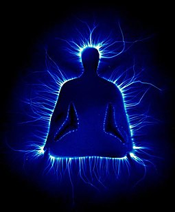 A Kirlian photo showing an artistic representation of a man in the Lotus position, surrounded by a blue glow Lotus Kirlian.jpg