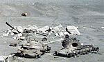 M48 tank wrecks at Suez Canal 1981.jpg
