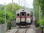 MBTA 1505 passing private crossing for Needham Golf Club, May 2012.JPG