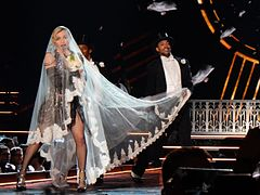 4057ccb03 Madonna, wearing a white bridal veil, performs