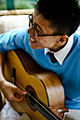 Male Chinese teenager playing the guitar.jpg
