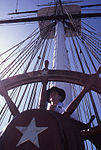 Man at the helm of the USS Constitution (8657138615).jpg