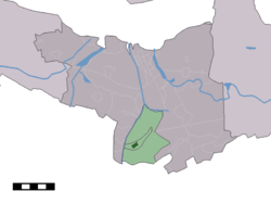 The village centre (dark green) and the statistical district (light green) of Westdorpe in the municipality of Terneuzen.