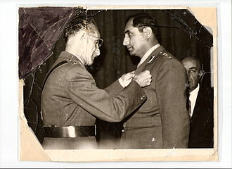 Mohammed Asif Safi - General Asif Khan receiving a medal of honor from Sardar Shah Wali Khan and then Prime Minister Daoud Khan in the background.