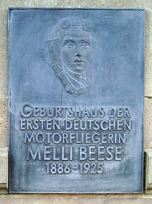 "Amelie Beese - Commemorative plaque at the birthplace of Melli Beese in Dresden-Laubegast. The inscription reads ""Birthplace of the first German female airplane pilot."""