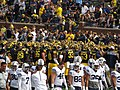 Michigan and BYU Teams Gathering Before Leaving Field, Michigan Stadium, University of Michigan, Ann Arbor, Michigan (21122352884).jpg
