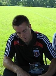 Miloš Kočić signing autographs at the Maryland Soccerplex.JPG
