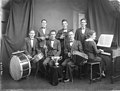 Musical septet with intruments and trophy (21865307578).jpg