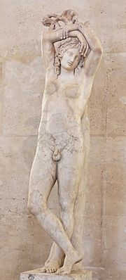 """Narcissus, also known as the """"Mazarini Hermaphroditus"""" or the """"Genie of eternal rest"""". The statue is composed of an antique funeral bust and of an antique lower part, assembled in modern times. Marble, 3rd century AD."""