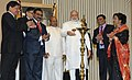 Narendra Modi lighting the lamp to inaugurate the National Conference of Dalit Entrepreneurs, organised by the DICCI, in New Delhi. The Union Minister for Social Justice and Empowerment.jpg