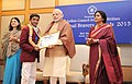 Narendra Modi presenting the National Bravery Awards 2015 to the children, in New Delhi on January 24, 2016. The Union Minister for Women and Child Development, Smt. Maneka Sanjay Gandhi is also seen (9).jpg