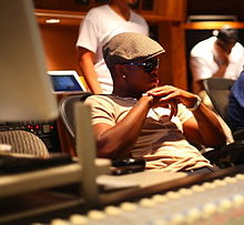 A picture of young African-American man in a recording studio who is looking forward
