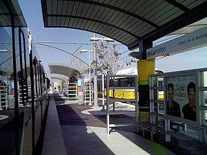 North Carrollton/Frankford station - DART Green Line light rail cars awaiting departure.