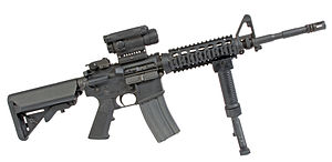 Picatinny rail - The M4 carbine with a Picatinny rail system, Grip Pod vertical forward grip, and M68 CCO sight