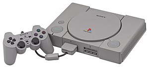 A Sony PlayStation (SCPH-5001), shown with a D...