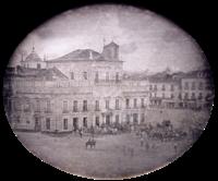 Foto montranta la Imperiestran kastelon en Rio-de-Ĵanejro kun ĉaroj kaj surĉevala honorgvardio en la placo frontante al la palaco.
