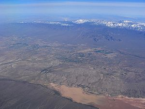 An aerial view from March 2005 shows development scattered across the valley floor.