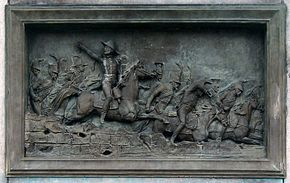 Plaque showing General Pajol leading a cavalry charge at the Battle of Montereau.