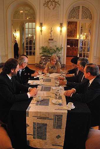 Uruguayan officials conversing at a meeting at the Palacio Taranco, 6 November 2010 Palacio Taranco meeting.jpg