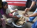 Palm root selling in street.JPG