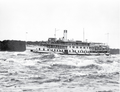 Passenger vessel Rapids Prince transits the Long Sault Rapids, near Cornwall, on the St. Lawrence River..png