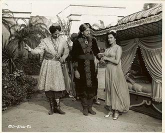 Siren of Bagdad - Hans Conried, Paul Henreid and Patricia Medina in a film still taken by Homer Van Pelt