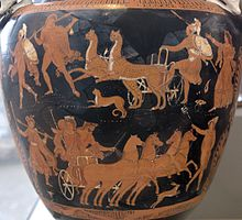 Detail of a Greek red-figure vase. There are two rows of figures. On the top row, two men stand to the left; in the centre two leopards pull a chariot which an armoured man in climbing on to; on the right stands a woman, arm outstretched. On the bottom row, four horses pull a chariot carrying a man and a woman in the centre; a female figure stands to the left, and a male figure stands to the right.