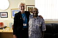Phoebe Anderson, AusAID Communications and Media Officer, hugs Archbishop Tutu (10713021254).jpg