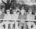 Photograph of dignitaries on the reviewing stand during the Armed Forces Day parade, (left to right) General Dwight... - NARA - 200224.tif