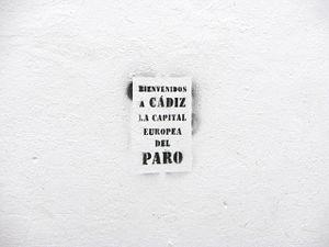 Español: Pintada en Cádiz sobre el paro: Bienv...