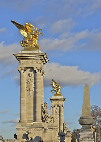 Pont Alexandre III - Gilded Fames sculptures on the socle counterweights.