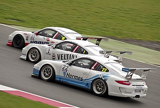 Overtaking - Battle for position between Kuba Giermaziak, Norbert Siedler and Nicki Thiim during the 2012 Porsche Supercup race at Silverstone.