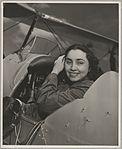Portrait of Begum Haroom in the cockpit of a biplane, ca. 1953 (15669881303).jpg