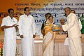 Pratibha Devisingh Patil presenting the Indira Gandhi Rajbhasha Award 2007-08 to Secretary, Ministry of Micro, Small & Medium Enterprises, Shri Dinesh Rai on behalf of Ministry of Micro, Small & Medium Enterprises.jpg