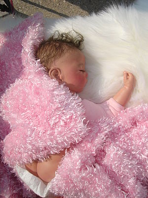"""Reborn doll - A typical reborn doll. Note the added cloth body on the limbs, and the """"rear plate"""" to make it more realistic."""