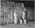 Red Cross field men preparing to ship gift boxes to servicemen fighting on Leyte and other islands in the... - NARA - 535572.tif