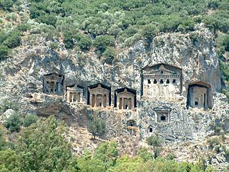 Rock-cut architecture - Lycian tombs cut into the cliffs along the river in Dalyan, Turkey.