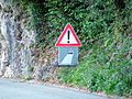 Road sign in Plesio.JPG