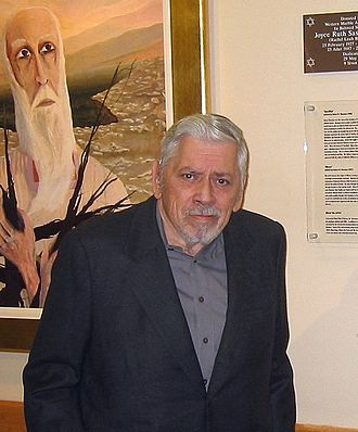 "Robert B. Sherman - Sherman dedicating a print of his painting, ""Sacrifice"" (Behind) to the Western Marble Arch Synagogue in London in 2004.  Officiating was Dr. Jonathan Sacks, Chief Rabbi of the British Empire and Commonwealth."