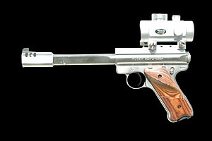 Ruger MK II - Ruger Mark II Stainless Slab side Competition Target Model 22LR pistol with a Volquartsen profiled slab side V-Comp compensator, reflex sight mounted on a Volquartsen Weaver-style rail, 6 7/8 in precision-crowned barrel, and checkered thumbrest target grips.