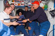 STS117 crew give packages