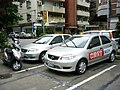 SYM scooter and Toyota Vios of Taiwan Secom 20100618.jpg