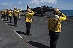 Sailors salute the pilot of an AV-8B Harrier before it takes off. (36617118701).jpg