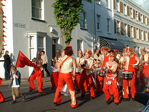 Kemptown, Brighton - A samba carnival processes through Kemptown streets