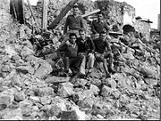 Sappers in a destroyed village