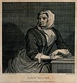 Sarah Malcolm sitting in prison with her hands resting on a Wellcome V0041240.jpg