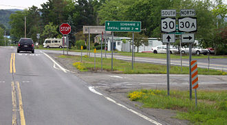 New York State Route 30 - NY 30 southbound, traffic stopping at the southern terminus of NY 30A, which does not stop.